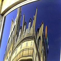 The top of an elegant characteristic Parisian building that is reflected and twisted in a mirror window (Paris, 2007).<br /> <br /> La cima di un elegante palazzo tipicamente Parigino, riflessa e distorta in una finestra a specchio (Parigi, 2007)