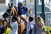 30th April 2021; Kentucky, USA;  Jockey John Velazquez celebrates with his team after riding Malathaat (10) to victory in the 147th running of the Longines Kentucky Oaks race on April 30th, 2021 at Churchill Downs in Louisville, KT.