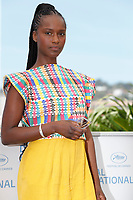 """CANNES, FRANCE - JULY 17: French actress Fatou N'Diaye at photocall for the film """"OSS 117 : Alerte Rouge en Afrique Noire"""" (OSS 117 : From Africa With Love) at the 74th annual Cannes Film Festival in Cannes, France on July 17, 2021 <br /> CAP/GOL<br /> ©GOL/Capital Pictures"""