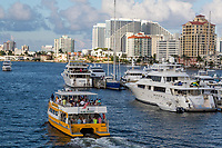 Ft. Lauderdale, Florida.  Double-decker Water Taxi in the Intracoastal Waterway.  W Hotel in the Background.