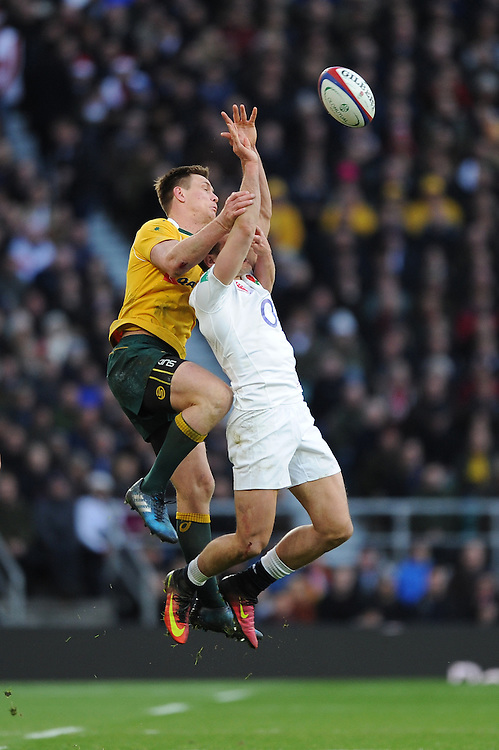 Dane Haylett-Petty of Australia and Jonny May of England compete for the high ball during the Old Mutual Wealth Series match between England and Australia at Twickenham Stadium on Saturday 3rd December 2016 (Photo by Rob Munro)