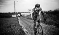 last (but 1) rider over the cobbles with the broom wagon behind<br /> <br /> GP Samyn 2016