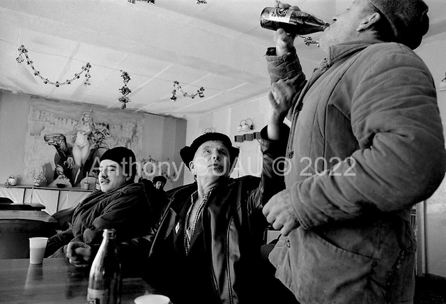 Rudichnii, Russia  .March 1999.At 9AM a small gathering of men, most of who were former prisoners are already drunk..
