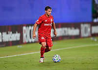LAKE BUENA VISTA, FL - JULY 26: Pablo Piatti of Toronto FC dribbles the ball during a game between New York City FC and Toronto FC at ESPN Wide World of Sports on July 26, 2020 in Lake Buena Vista, Florida.
