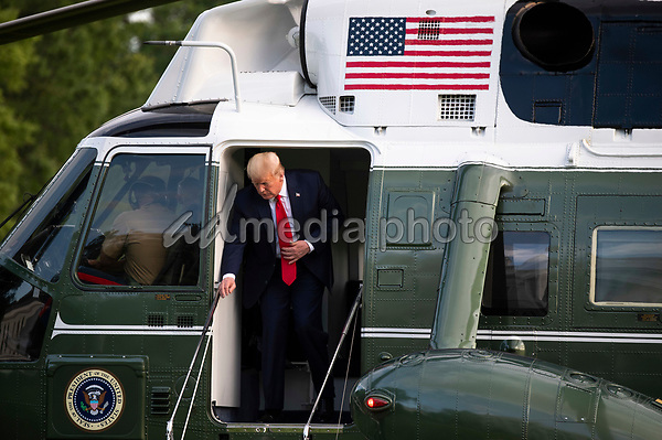 President Donald Trump returns to the White House in Washington, DC on Wednesday, May 27, 2020. President Trump and the First Lady are returning from NASA's Kennedy Space Center where they were scheduled to watch the SpaceX Mission 2 launch. The launch was postponed due to weather. <br /> Credit: Kevin Dietsch / Pool via CNP/AdMedia