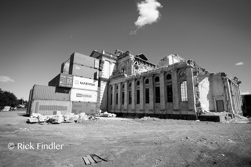 Shipping crates offer support to Christchurch's Catholic Cathedral after continual damage from recurring earthquakes.