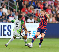 AUSTIN, TX - JUNE 16: Samantha Mewis #3 of the United States passes the ball in front of Onome Ebi #5 of Nigeria during a game between Nigeria and USWNT at Q2 Stadium on June 16, 2021 in Austin, Texas.