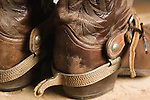 horizontal cowboy boots spurs still life ranch ranching western horseback riding leather