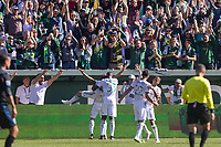 Portland, Oregon - Sunday October 6, 2019: Sebastian Blanco #10 and the Portland Timbers celebrate scoring a goal in the front of the Portland Timbers fans during a regular season match between Portland Timbers and San Jose Earthquakes at Providence Park in Portland, Oregon.