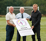 26.08.2019 Hillwood Community Trust football pitches: Ian Durrant and Tommy Coyne with Willie Smith at Priesthill, Glasgow