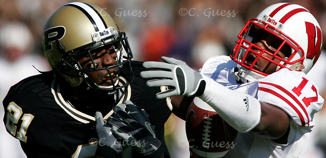 UW?s Allen Langford wrestles with Purdue?s Greg Orton over a possible interception in the Wisconsin vs. Purdue match up held in Ross-Ade Stadium on October 21, 2006. Wisconsin would go on to win the game in a crushing 24-3 victory.