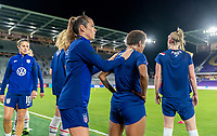 ORLANDO, FL - JANUARY 18: Kelley O'Hara #5 and Crystal Dunn #19 of the USWNT warm up before a game between Colombia and USWNT at Exploria Stadium on January 18, 2021 in Orlando, Florida.