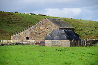 Stone barn with big bales of silage covered with netting for protection from birds, Cumbria....Copyright..John Eveson, Dinkling Green Farm, Whitewell, Clitheroe, Lancashire. BB7 3BN.01995 61280. 07973 482705.j.r.eveson@btinternet.com.www.johneveson.com