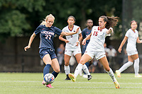 NEWTON, MA - AUGUST 29: Abbey Jones #27 of University of Connecticut passes the ball as Samantha Agresti #15 of Boston College defends during a game between University of Connecticut and Boston College at Newton Campus Soccer Field on August 29, 2021 in Newton, Massachusetts.