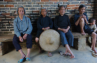 Elderly ladies in a typical village in Huaji, Guangdong Province, China. Women and elderly men and children live in this   countryside village in China, with most men leaving for better paid jobs in contruction in the cities and factory areas.<br /> 20-APR-04