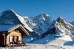 CHE, Schweiz, Kanton Bern, Berner Oberland, Grindelwald: die letzten Sonnenstrahlen im Maennlichen Skigebiet mit Eiger (3.970 m), Mönch (4.107 m), Tschuggen (2.520 m) - von links nach rechts   CHE, Switzerland, Canton Bern, Bernese Oberland, Grindelwald: Maennlichen top station with Eiger (3.970 m), Moench (4.107 m) and Tschuggen (2.520 m)