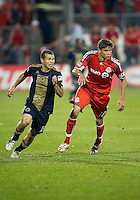 15 April 2010: Philadelphia Union forward Alejandro Moreno #15 and Toronto FC defender Adrian Can #12 in action during a game between the Philadelphia Union and Toronto FC at BMO Field in Toronto..Toronto FC won 2-1..Photo by Nick Turchiaro/isiphotos.com........12 September 2009:Toronto FC forward Chad Barrett # 19 takes the ball up field during MLS action at BMO Field Toronto in a game between Colorado Rapids and Toronto FC. .Photo by Nick Turchiaro/isiphotos.comApril 12 2010: Chicago White Sox second baseman Gordon Beckham #15 and Chicago White Sox shortstop Omar Vizquel #11celebrate the win during the Toronto Blue Jays home opener between the Chicago White Sox and the Toronto Blue Jays at Rogers Centre in Toronto, Ontario..The White Sox won 8-7 in 11 innings.........11 April 2009:Toronto FC forward Chad Barrett # 19 takes the ball up field during MLS action at BMO Field Toronto, in a game between FC Dallas and Toronto FC. .Toronto FC won 2-1.