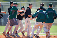 Plymouth State Panthers Luke Mancini (19) is mobbed by teammates after a walk off victory during the first game of a doubleheader against the Edgewood Eagles on March 17, 2016 at Lee County Player Development Complex in Fort Myers, Florida.  Plymouth State defeated Edgewood 6-5.  (Mike Janes/Four Seam Images)