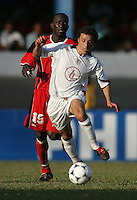 09 February, 2005. Carlos Bocanegra (4) of the USMNT sprints away from Trinidad and Tobago's Kenwyne Jones (15) during the World Cup qualifier at Queen's Park Oval in Port of Spain, Trinidad and Tobago.  The USMNT defended Trinidad and Tobago 2-1.