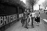 Chiswick Women Aid Shelter for Battered Women. Richmond  London England 1975. Two mothers and their children who are staying in the hosel walking to local shops.