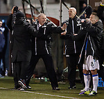 Ally McCoist celebrates after Nicky Law scores his second goal to seal the match
