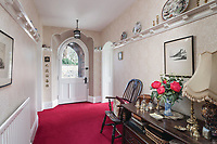 BNPS.co.uk (01202) 558833. <br /> Pic: SandersonYoung/BNPS<br /> <br /> Hallway.<br /> <br /> A quirky 'show home' for a brickwork owner where Lewis Carroll is believed to have stayed while writing some of his Alice in Wonderland books is on the market for just under £1m.<br /> <br /> Red Cottage is a striking Grade II listed property in Whitburn, Tyne and Wear, where Charles Dodgson, otherwise known as Lewis Carroll, regularly visited family.<br /> <br /> The unusual 179-year-old home was built to show off as many design features as possible, and has a walled garden and even an air raid shelter.