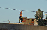 typical narco survillance in the roofs in Lomas de Zamora outskirts