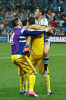 Maxi Rodriguez of Argentina celebrate scoring the winning penalty with Goalkeeper Sergio Romero