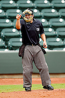Home plate umpire Lawrence Reeves makes a strike call during the Carolina League game between the Potomac Nationals and the Winston-Salem Dash at BB&T Ballpark on April 25, 2012 in Winston-Salem, North Carolina.  The Dash defeated the Nationals 14-0.  (Brian Westerholt/Four Seam Images)
