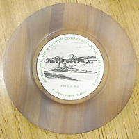 Keith Bryant/The Weekly Vista<br /> A commemorative plate from the 1972 Football Coaches Invitational Golf Tournament, featuring an image of the Country Club, is on display at the Bella Vista Historical Museum.