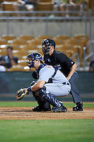 Salt River Rafters Grayson Greiner (15), of the Detroit Tigers organization, and umpire Travis Eggert during a game against the Glendale Desert Dogs on October 19, 2016 at Camelback Ranch in Glendale, Arizona.  Salt River defeated Glendale 4-2.  (Mike Janes/Four Seam Images)