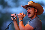 Dustin Lynch performs at the TJ's Corral Outdoor Events Center at the Carson Valley Inn in Minden, Nev., on Thursday, June 12, 2014.<br /> Photo by Cathleen Allison