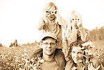 Manitoba family hiking in a field of sunflowers.