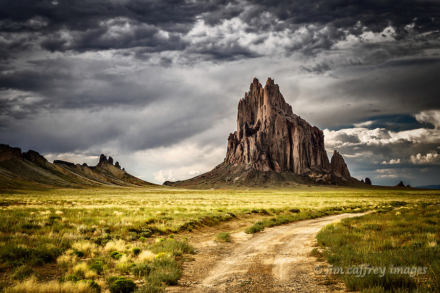 Shiprock glows in the evening light against a stormy sky in northwest New Mexico.