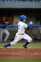 Bluefield Blue Jays third baseman Rafael Lantigua (25) follows through on a swing during the second game of a doubleheader against the Bristol Pirates on July 25, 2018 at Bowen Field in Bluefield, Virginia.  Bristol defeated Bluefield 5-2.  (Mike Janes/Four Seam Images)