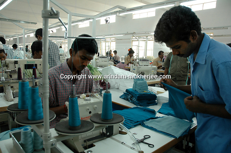 Indian workers working at Srinidhi Industry's garment stitching factory in Tirupur, Tamilnadu. After lifting of quota system in textile export on 1st january 2005. Tirupur has become the biggest foreign currency earning town of India.