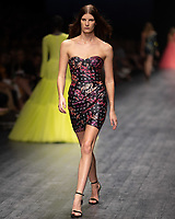 A model wearing a design by Jason Grech walks at the Runway 3 show of the 2020 Virgin Australian Melbourne Fashion at the Royal Exhibition Building in Melbourne, Australia. Photo Sydney Low