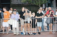 Bystanders watch as people march in the Straight Pride Parade in Boston, Massachusetts, on Sat., August 31, 2019.