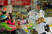10 January 2009: A young hockey fan holds up a picture as University of Vermont Catamount forward and Team Captain Dean Strong, a Senior from Mississauga, Ontario skates by prior to a game against the Boston College Eagles in the second matchup of a weekend series at Gutterson Fieldhouse in Burlington, Vermont. The Catamounts rallied from an early 2-0 deficit to defeat the visiting Eagles 4-2. Mandatory Photo Credit: Ed Wolfstein Photo
