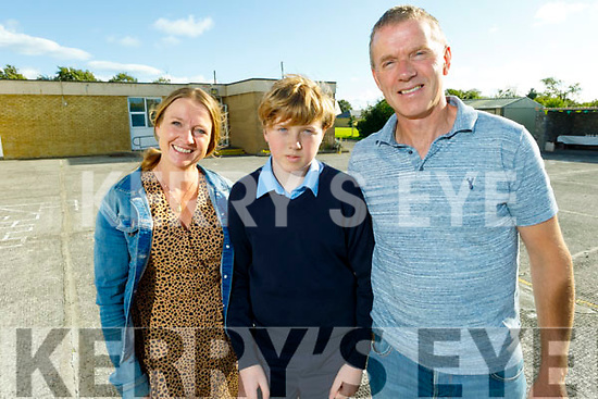 Seanie Jeffers graduating from Ardfert NS on Thursday standing with his parents Kathleen and John Jeffers.