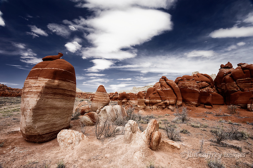 One lone standing red and white stone in Blue Canyon on the Hopi Reservation in northeastern Arizona
