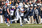 Navy Midshipmen quarterback Keenan Reynolds (19) and Middle Tennessee Blue Raiders defensive end Jiajuan Fennell (97) in action during the Armed Forces Bowl game between the Middle Tennessee Blue Raiders and the Navy Midshipmen at the Amon G. Carter Stadium in Fort Worth, Texas. Navy defeated Middle Tennessee 24 to 6.