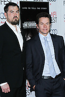 """HOLLYWOOD, CA - NOVEMBER 12: Marcus Luttrell, Mark Wahlberg at the AFI FEST 2013 - """"Lone Survivor"""" Premiere held at TCL Chinese Theatre on November 12, 2013 in Hollywood, California. (Photo by David Acosta/Celebrity Monitor)"""