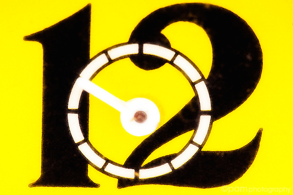 close up of the number 12 on yellow vintage alarm clock
