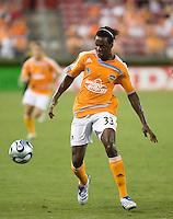 Houston Dynamo forward Joseph Ngwenya (33) dribbles the ball. The Houston Dynamo tied the Columbus Crew 1-1 in a regular season MLS match at Robertson Stadium in Houston, TX on August 25, 2007.
