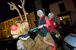 The Christmas lights turn on parade through Swansea City Centre..