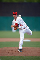 Auburn Doubledays relief pitcher Jonny Reid (12) follows through on a pitch during the second game of a doubleheader against the Mahoning Valley Scrappers on July 2, 2017 at Falcon Park in Auburn, New York.  Mahoning Valley defeated Auburn 3-2.  (Mike Janes/Four Seam Images)