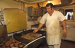 Ullapool Scotland. 1986. Loch Broom. A Bulgarian factory fishing boat. Chef preparing dinner.
