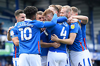 Portsmouth players mob Tom Naylor of Portsmouth after the first goal during Portsmouth vs MK Dons, Sky Bet EFL League 1 Football at Fratton Park on 10th October 2020