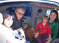 *** EXCLUSIVE Coverage ***<br /> Woody Allen with his wife Soon-Yi Previn and daughters Bechet and Manzie Allen arriving in Lisbon, Portugal.<br /> ( picyured in their stretch limo car )<br /> Debember 30, 2004<br /> Credit: Walter McBride/MediaPunch